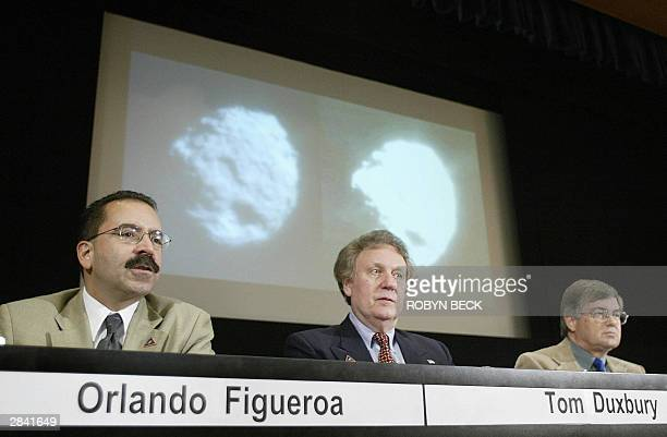 Tom Duxbury Stardust project manager is flanked by NASA's director of solar systems exploration Orlando Figueroa and Stardust principal investigator...
