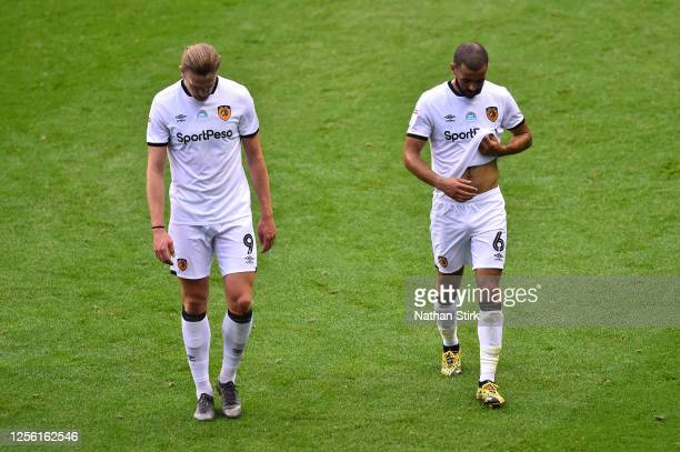 Tom Eaves and Kevin Stewart of Hull City walk off dejected after the Sky Bet Championship match between Wigan Athletic and Hull City at DW Stadium on...