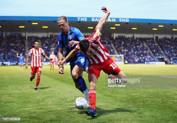 Tom Eaves of Gillingham battles for posession with Jack Baldwin of Sunderland during the Sky Bet League One match between Gillingham and Sunderland...