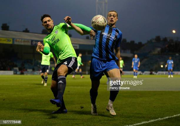 Tom Eaves of Gillingham battles for possession with Sean Morrison of Cardiff City during the FA Cup Third Round match between Gillingham and Cardiff...