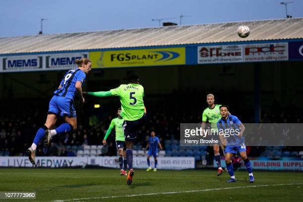 Tom Eaves of Gillingham heads towards goal during the FA Cup Third Round match between Gillingham and Cardiff City at Priestfield Stadium on January...