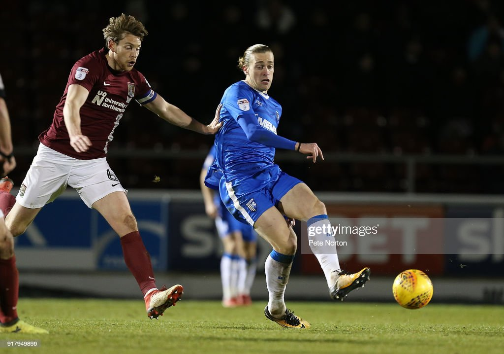 Tom Eaves of Gillingham plays the ball away from Ash Taylor of Northampton Town during the Sky Bet League One match between Northampton Town and Gillingham at Sixfields on February 13, 2018 in Northampton, England.