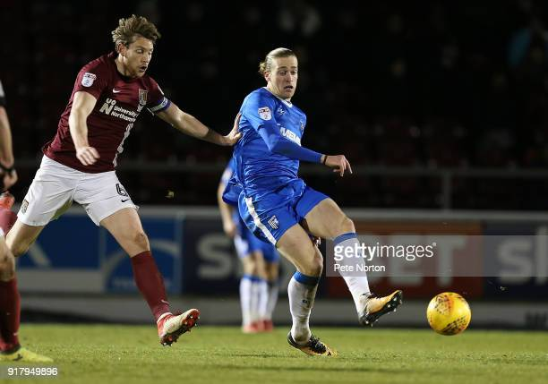 Tom Eaves of Gillingham plays the ball away from Ash Taylor of Northampton Town during the Sky Bet League One match between Northampton Town and...