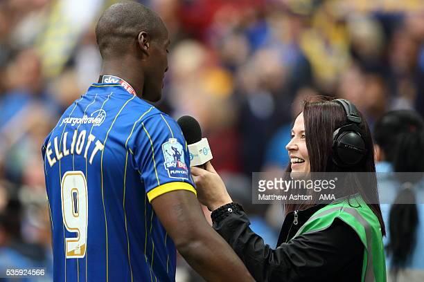 Tom Elliott of AFC Wimbledon gets interviewed by BBC Five Live football reporter Juliette Ferrington during the Sky Bet League Two Play Off Final...
