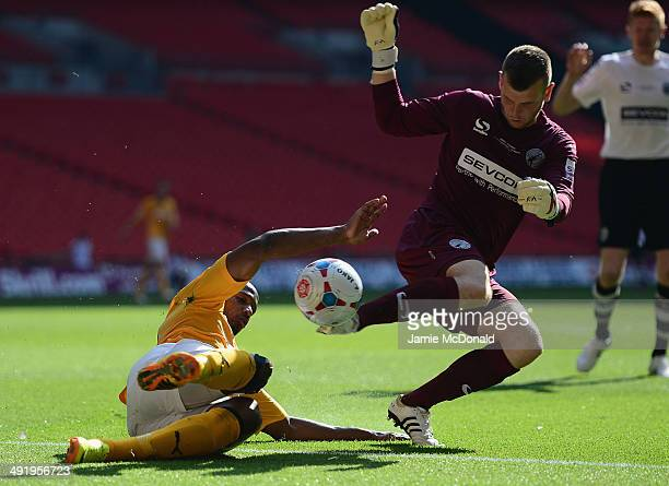 Tom Elliott of Cambridge United battles with Adam Barlett of Gateshead United during the Skrill Conference Premier PlayOffs Final between Cambridge...