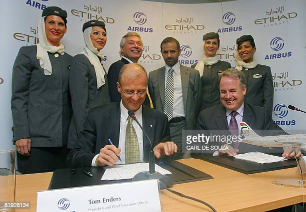 Tom Enders CEO of Airbus and James Hogan CEO of Etihad sign contracts during a photocall at Farnborough Airshow Hampshire on July 14 2008 Etihad...