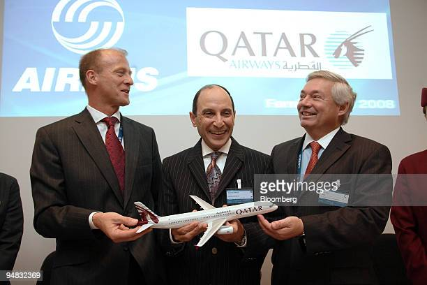 Tom Enders chief executive officer of Airbus left Akbar alBaker chief executive officer of Qatar Airways center and John Leahy chief commercial...