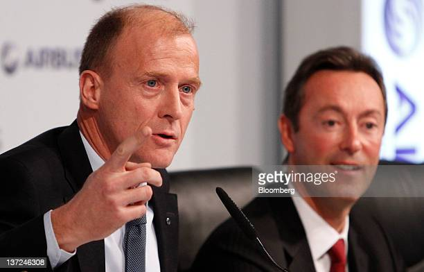 Tom Enders, chief executive officer of Airbus SAS, left, gestures as Fabrice Bregie, chief operating officer of Airbus SAS, listens during a news...
