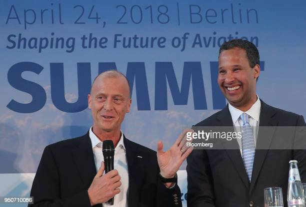 Tom Enders chief executive officer of Airbus SE left speaks as BertrandMarc Allen president of Boeing Co reacts at the Berlin Aviation Summit in...