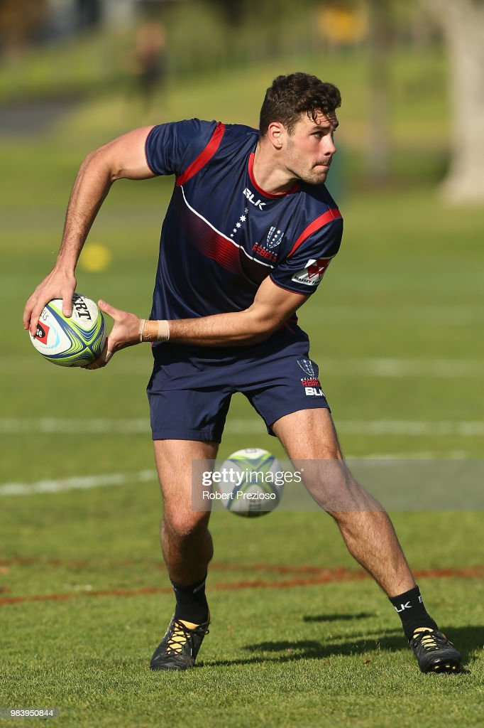 Tom English looks to offload during a Melbourne Rebels Super Rugby training session at AAMI Park on June 26, 2018 in Melbourne, Australia.