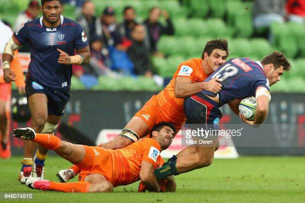 Tom English of the Rebals is tackled during the round nine Super Rugby match between the Rebels and the Jaguares at AAMI Park on April 14 2018 in...