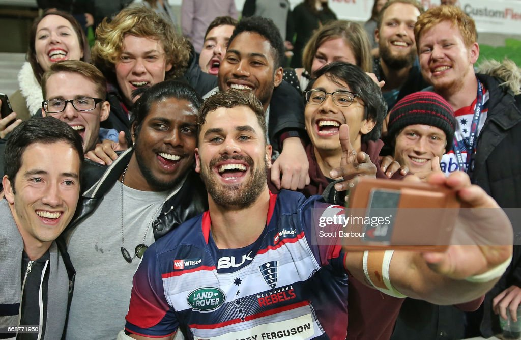 Tom English of the Rebels and Rebels supporters in the crowd celebrate after they won the round eight Super Rugby match between the Rebels and the Brumbies at AAMI Park on April 15, 2017 in Melbourne, Australia.