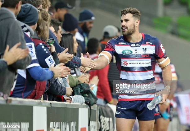 Tom English of the Rebels and Rebels supporters in the crowd celebrate after they won the round eight Super Rugby match between the Rebels and the...