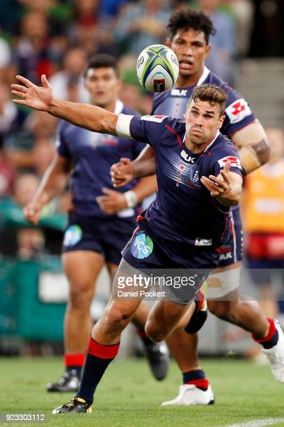 Tom English of the Rebels catches a stray pass during the round two Super Rugby match between the Melbourne Rebels and the Queensland Reds at AAMI...