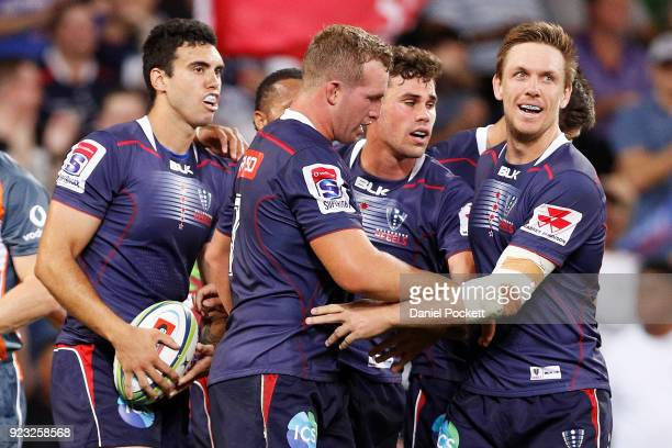 Tom English of the Rebels celebrates a try with teammates during the round two Super Rugby match between the Melbourne Rebels and the Queensland Reds...