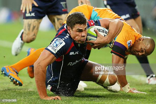 Tom English of the Rebels crawls for the try line ahead of Cornal Hendricks of the Cheeters during the round three Super Rugby match between the...
