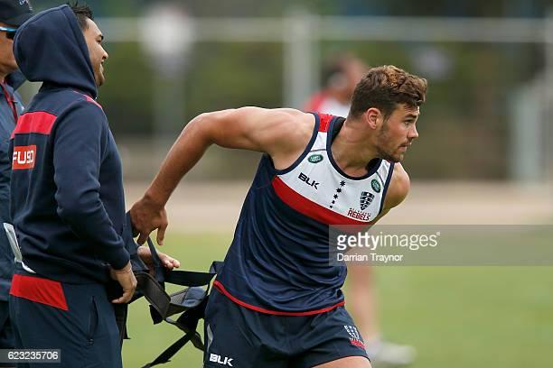 Tom English of the Rebels discards a shoulder brace during a Melbourne Rebels Super Rugby training session on November 15 2016 in Melbourne Australia