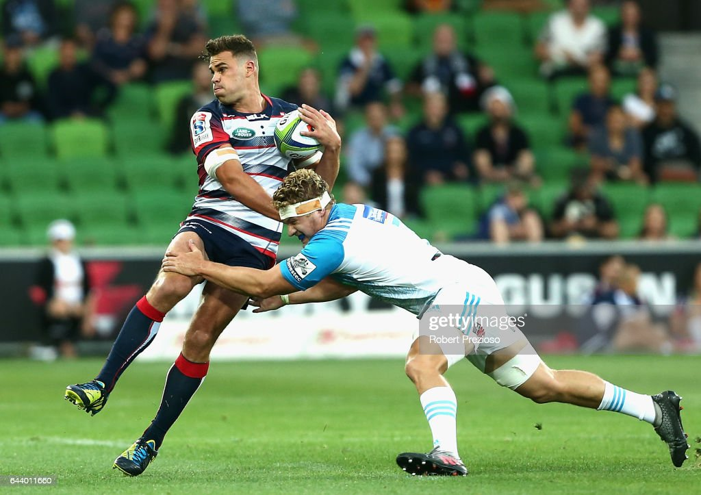 Tom English of the Rebels is tackled during the round one Super Rugby match between the Melbourne Rebels and the Auckland Blues at AAMI Park on February 23, 2017 in Melbourne, Australia.