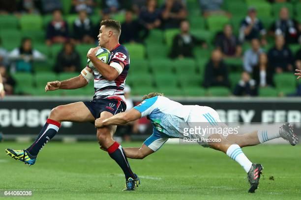 Tom English of the Rebels is tackled during the round one Super Rugby match between the Melbourne Rebels and the Auckland Blues at AAMI Park on...