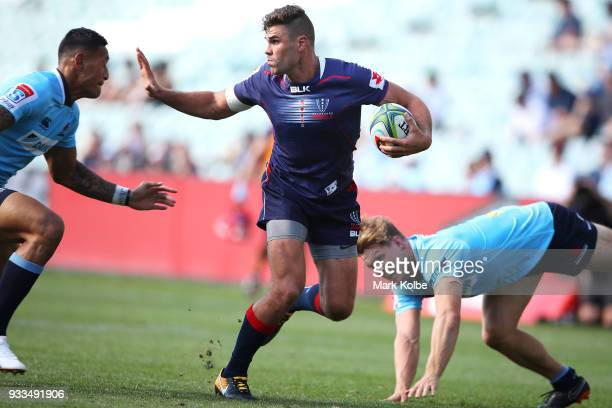 Tom English of the Rebels runs the ball during the round five Super Rugby match between the Waratahs and the Rebels at Allianz Stadium on March 18...