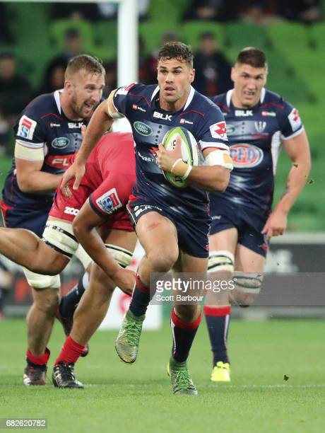 Tom English of the Rebels runs with the ball during the round 12 Super Rugby match between the Melbourne Rebels and the Queensland Reds at AAMI Park...