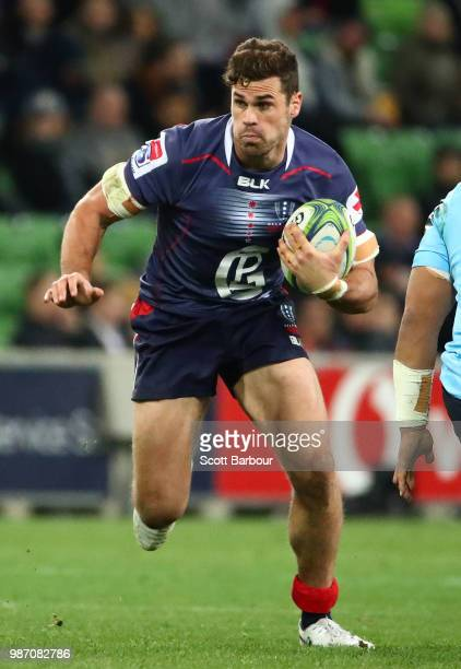 Tom English of the Rebels runs with the ball during the round 17 Super Rugby match between the Rebels and the Waratahs at AAMI Park on June 29 2018...