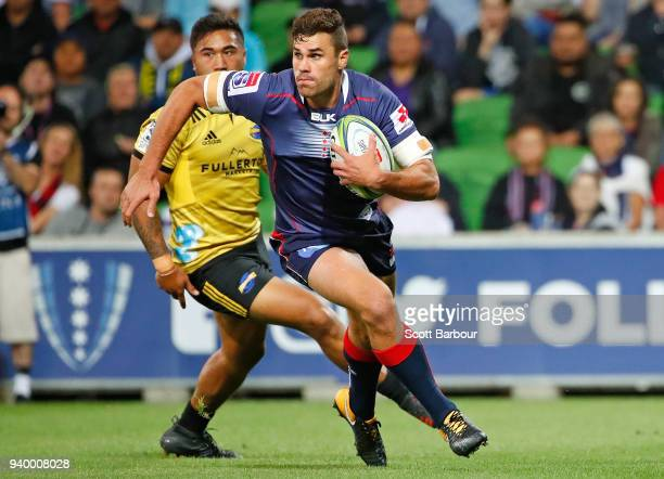 Tom English of the Rebels runs with the ball during the round seven Super Rugby match between the Rebels and the Hurricanes at AAMI Park on March 30...