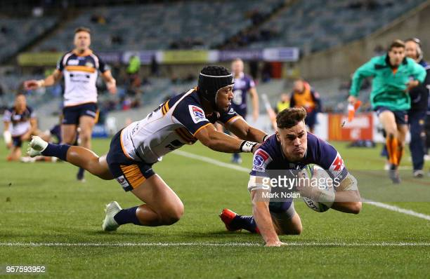 Tom English of the Rebels scores a try during the round 12 Super Rugby match between the Brumbies and the Rebels at GIO Stadium on May 12 2018 in...