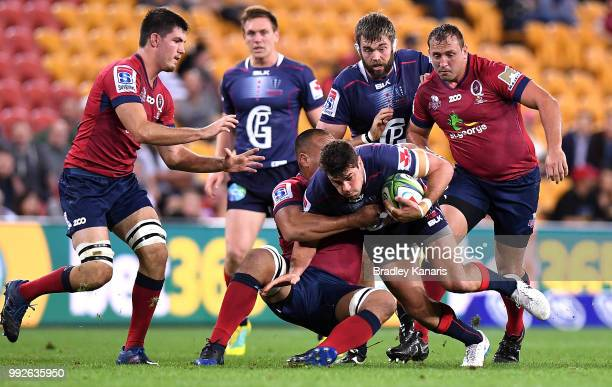 Tom English of the Rebels takes on the defence during the round 18 Super Rugby match between the Reds and the Rebels at Suncorp Stadium on July 6...