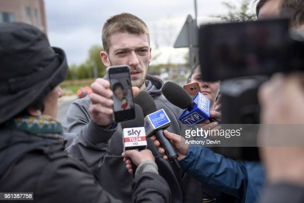 Tom Evans Father of Alfie Evans holds a photograph of his son as he speaks to media outside Alder Hey Children's Hospital on April 26 2018 in...