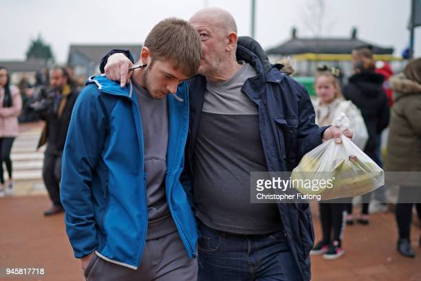 Tom Evans, the father of terminally ill 23-month-old Alfie Evans, is embraced by a supporter after speaking to the media outside Alder Hey Hospital...