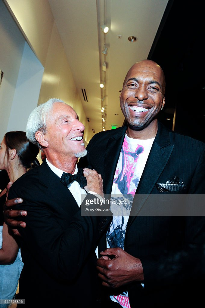 Tom Everhart and John Salley attend the 'Tom Everhart 'Raw' Exhibition of His Schulz-influenced Paintings For The First Time In Black And White At Mouche Gallery on February 27, 2016 in Beverly Hills, California.