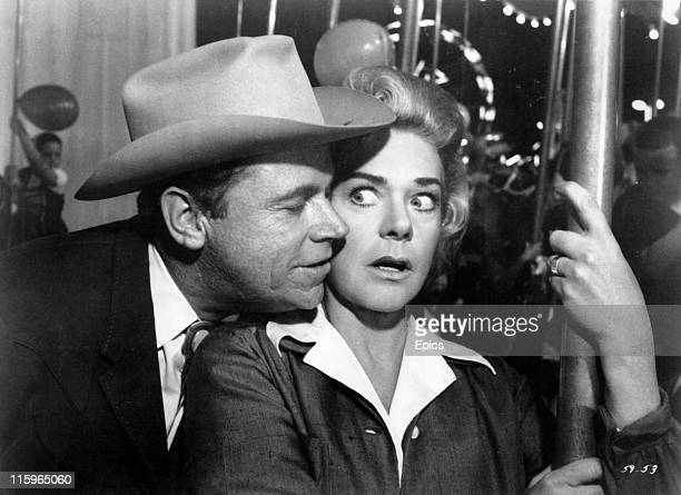 Tom Ewell and Alice Faye share a moment in a scene from the musical 'State Fair' directed by Jose Ferrer 1962