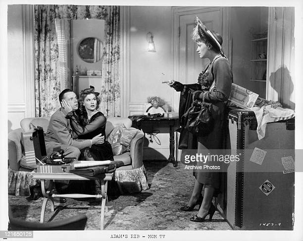 Tom Ewell and Jean Hagen have gun pointed at them by Judy Holliday in a scene from the film 'Adam's Rib' 1949