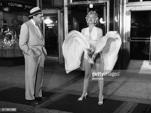 Tom Ewell and Marilyn Monroe in a scene from the movie The Seven Year Itch.