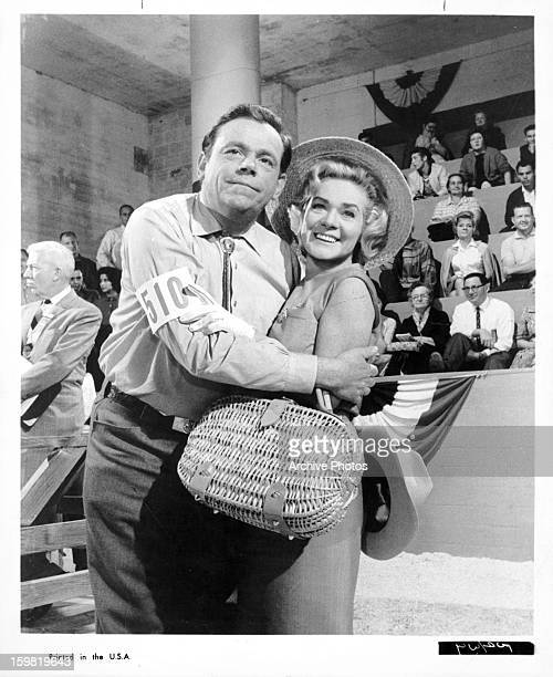 Tom Ewell holds Alice Faye in a scene from the film 'State Fair' 1962