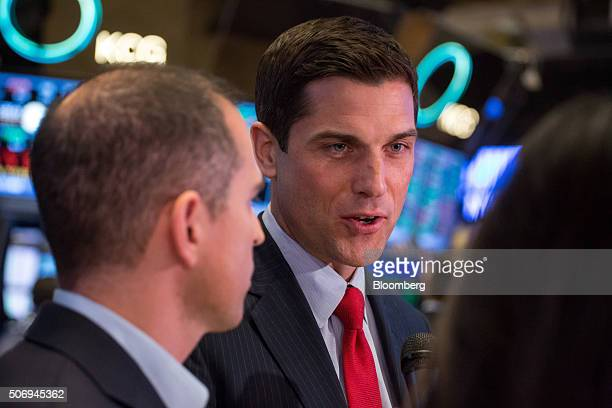 Tom Farley president of NYSE Group Inc right speaks as Ari Rubenstein chief executive officer and cofounder of Global Trading Systems LLC left...