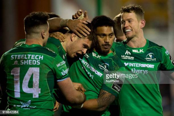 Tom Farrell of Connacht celebrates his try with Pita Akhi during the Guinness PRO14 rugby match between Connacht Rugby and Ospreys at the...