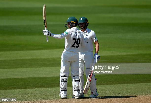 Tom Fell of Worcestershire celebrates his 50 with Joe Clarke of Worcestershire during day three of the Specsavers County Championship Division One...