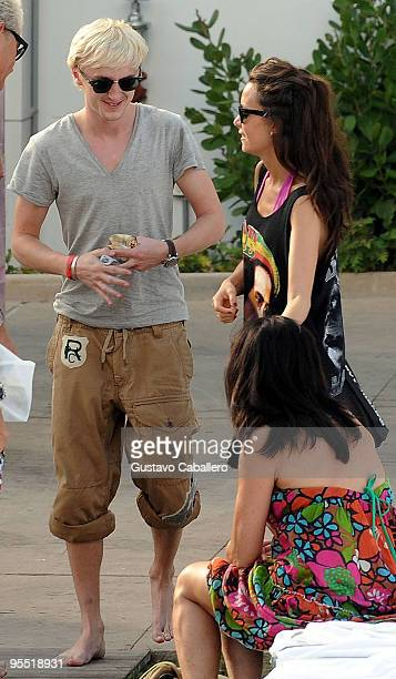 Tom Felton and his girlfriend are seen on Miami Beach on December 31 2009 in Miami