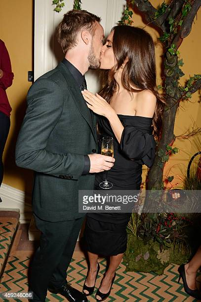 Tom Felton and Jade Olivia attend the Claridge's Dolce and Gabbana Christmas Tree party at Claridge's Hotel on November 19 2014 in London England