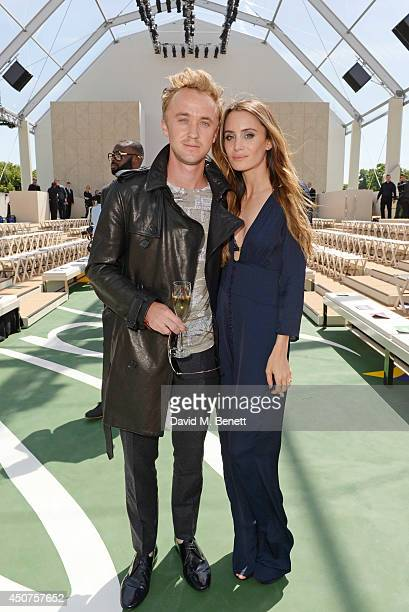 Tom Felton and Jade Olivia attends the front row at Burberry Prorsum SS15 during London Collections Men at Kensington Gardens on June 17 2014 in...
