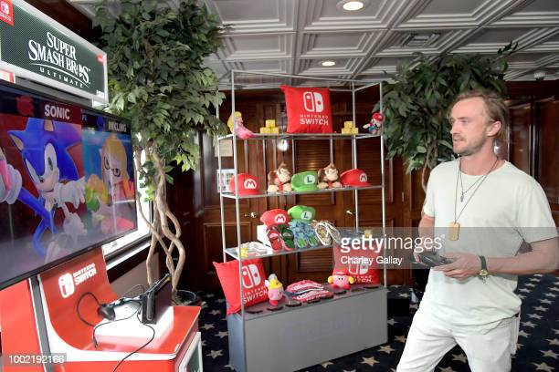 Tom Felton tests his skills on Super Smash Bros Ultimate for Nintendo Switch at the Variety Studio at ComicCon 2018 on July 19 2018 in San Diego...