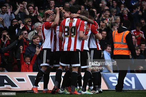 Tom Field celebrates with his Brentford team mates during the Sky Bet Championship match between Brentford and Fulham at Griffin Park on April 30...