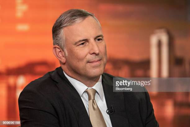 Tom Finke chairman and chief executive officer of Barings LLC listens during a Bloomberg Television interview in Hong Kong China on Friday May 18...