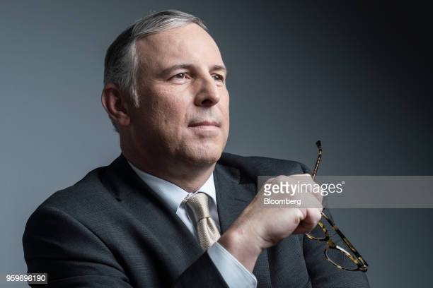 Tom Finke chairman and chief executive officer of Barings LLC poses for a photograph following a Bloomberg Television interview in Hong Kong China on...