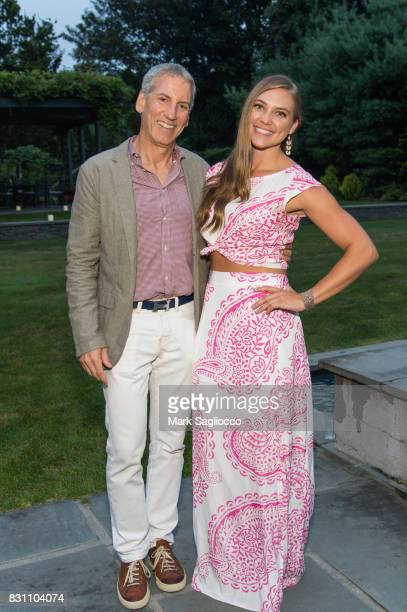 Tom Finnegan and Lauren Lester attend Hamptons Magazine's Private Dinner Celebrating East Hampton Library Authors Night on August 12 2017 in East...