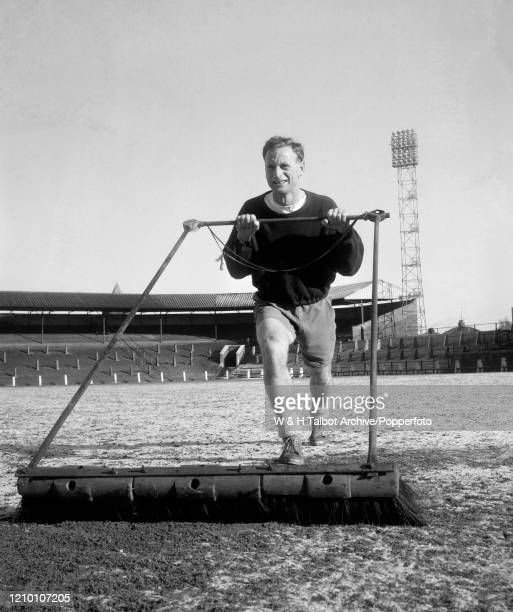 Tom Finney of Preston North End clearing snow from the pitch at Deepdale in Preston, England, circa March 1960.