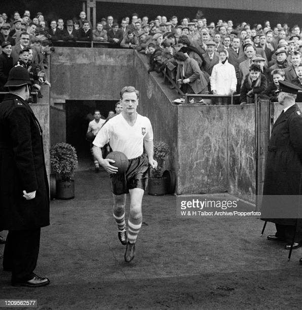 Tom Finney of Preston North End leads the team out before the Football League Division One match between Preston North End and West Ham United at...