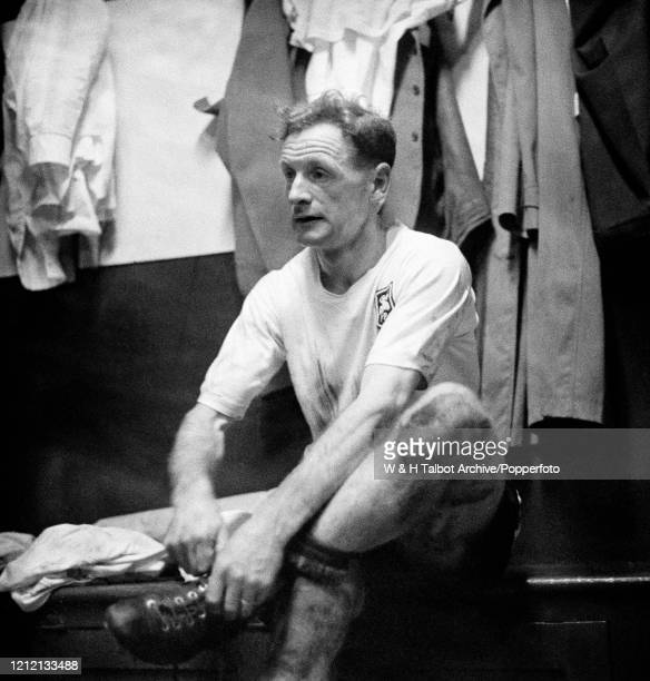 Tom Finney of Preston North End removes his boots in the changing room after the Football League Division One match between Preston North End and...